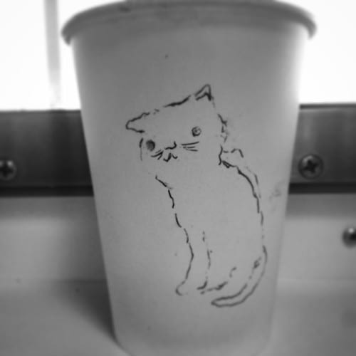 Drawing on a cup of coffee